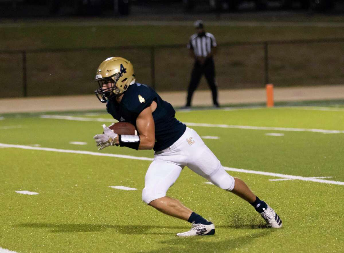 Lake Creek safety Pierce Morcos (4) catches a kick off during the second quarter against Travis during a non-district play at MISD stadium in Montgomery, Thursday, Oct. 8, 2020.