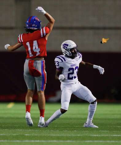 Oak Ridge wide receiver Landon Lightsey (14) looks for a flag against Humble cornerback Maceo Mckinney (23) during the second quarter of a non-district high school football game at Woodforest Bank Stadium, Thursday, Oct. 8, 2020, in Shenandoah. Mckinney was called for pass interference on the play. Photo: Jason Fochtman, Staff Photographer / 2020 © Houston Chronicle