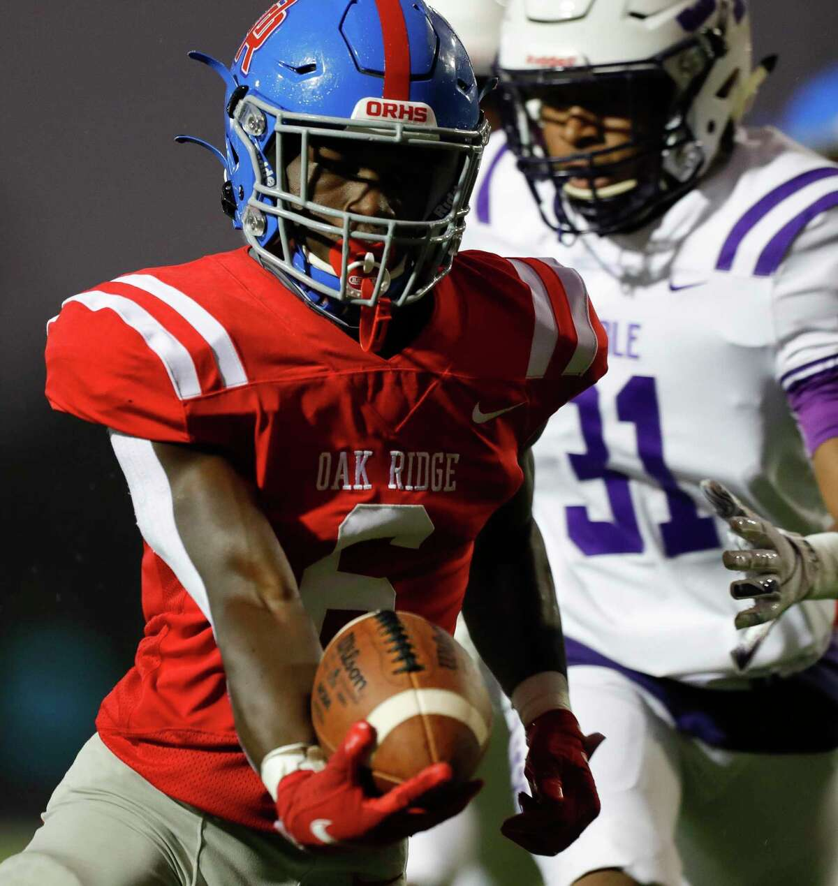 Oak Ridge wide receiver Jahron Jonas (6) runs the ball for a 15-yard touchdown during the first quarter of a non-district high school football game at Woodforest Bank Stadium, Thursday, Oct. 8, 2020, in Shenandoah.