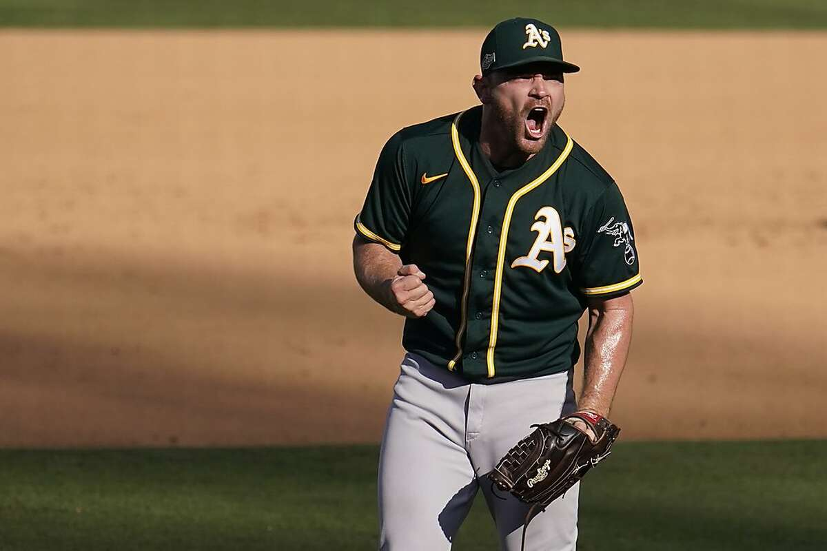 Oakland Athletics pitcher Liam Hendriks reacts after the Athletics defeated the Houston Astros in Game 3 of a baseball American League Division Series against the Houston Astros in Los Angeles, Wednesday, Oct. 7, 2020. (AP Photo/Marcio Jose Sanchez)