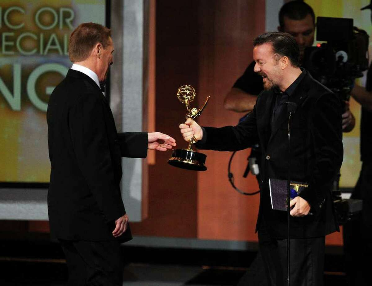 Wilton resident Bucky Gunts accepts the Outstanding Directing for a Variety, Music, or Comedy Special award from actor Ricky Gervais onstage at the 62nd Annual Primetime Emmy Awards held at the Nokia Theatre L.A. Live on August 29, 2010 in Los Angeles, California.