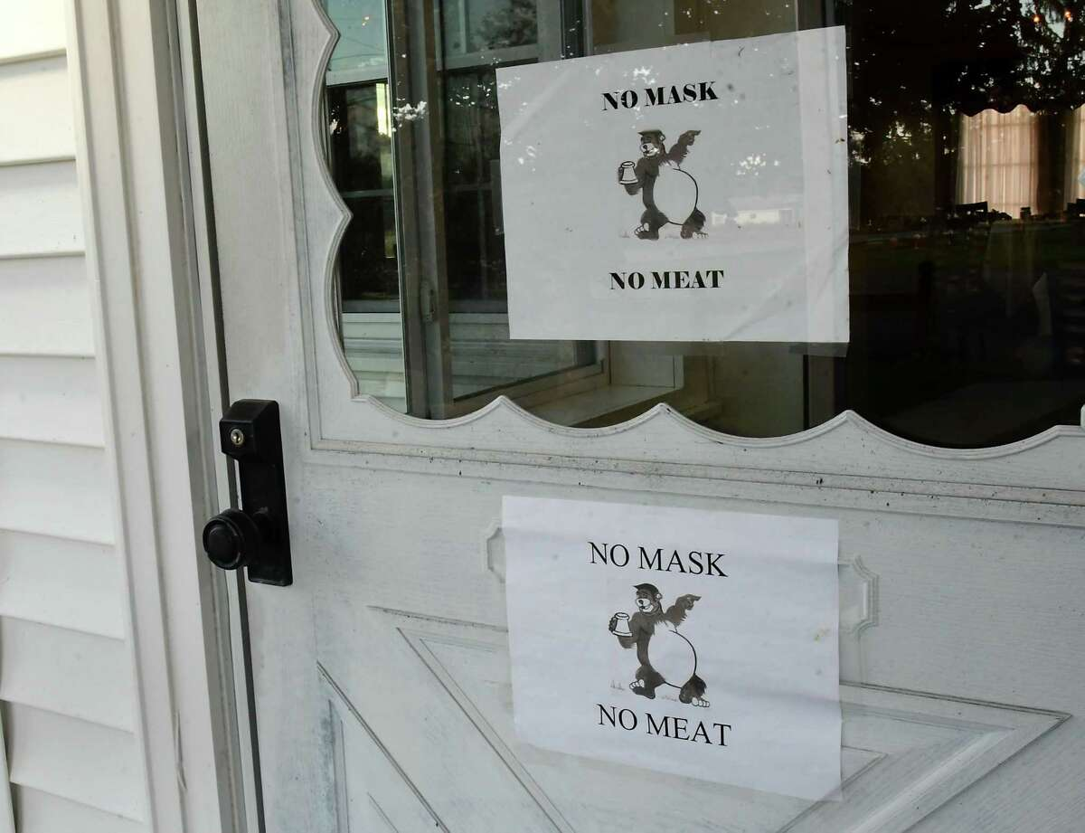 """Signs saying """"no mask, no meat"""" are displayed on the front door of The Bears' Steakhouse on Thursday, Oct. 8, 2020 in Duanesburg, N.Y. The restaurant was founded in 1969. (Lori Van Buren/Times Union)"""