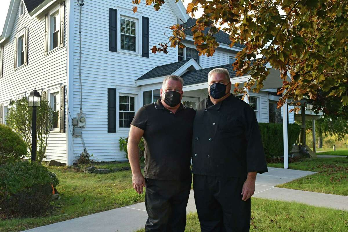 Owners John Payne, left, and his brother Robert Payne II stand outside The Bear's Steakhouse on Thursday, Oct. 8, 2020 in Duanesburg, N.Y. The restaurant was founded in 1969 by their parents. (Lori Van Buren/Times Union)
