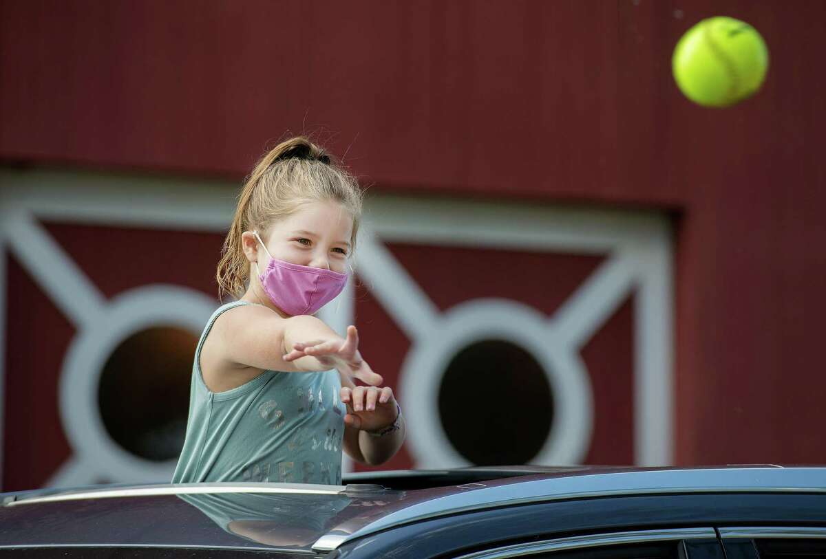 Maicey Streisand, 6, of Wilton throws a ball at the dunk tank.