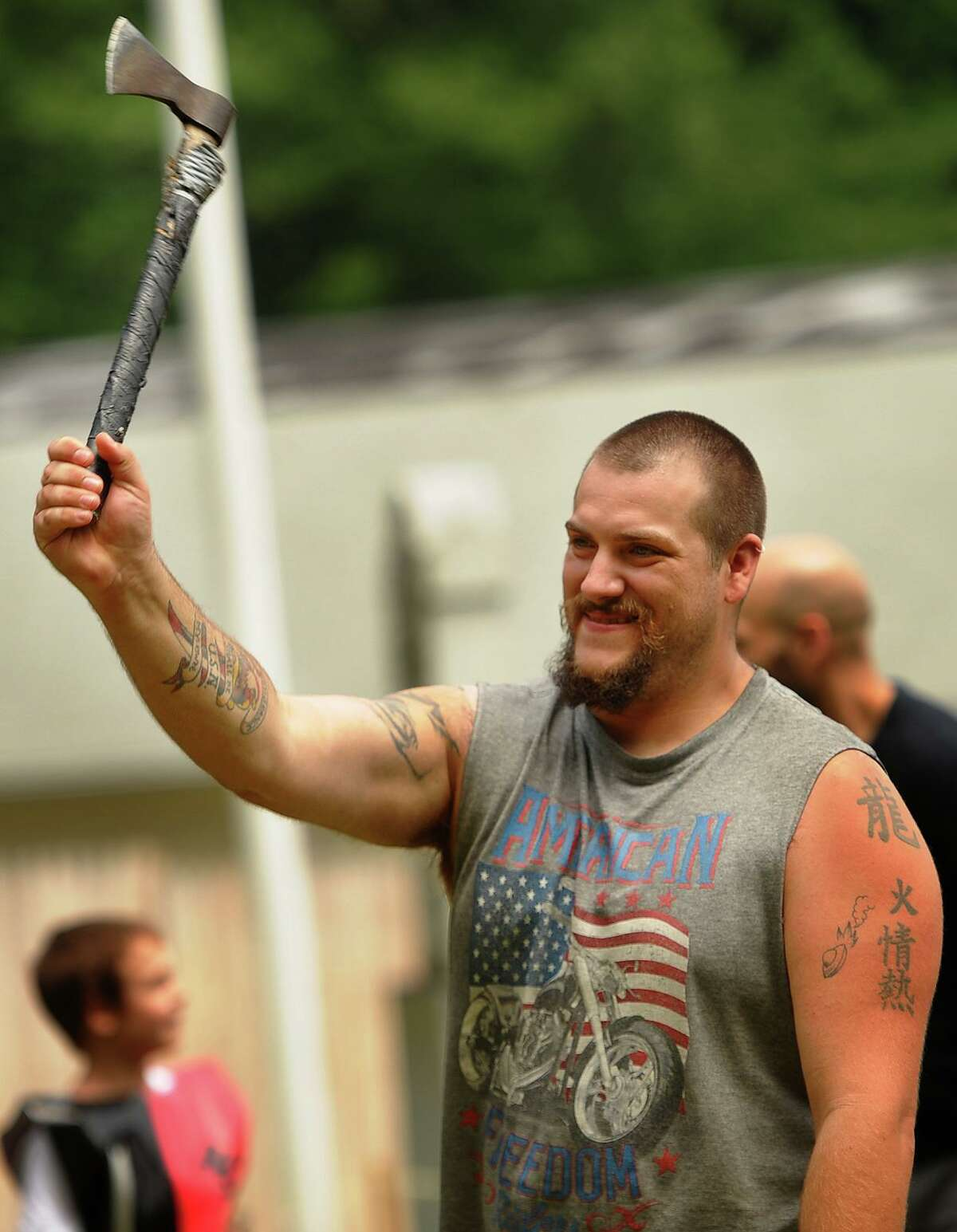 Joshua Patrick, of Ansonia, tries his hand at axe throwing at the annual Midsummer Fantasy Renaissance Faire at Warsaw Park in Ansonia in 2018.