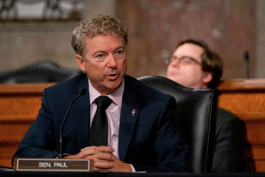 Sen. Rand Paul (R-Ky,), questions Dr. Anthony Fauci, director of the National Institute of Allergy and Infectious Diseases at the National Institutes of Health, as he testifies during a U.S. Senate hearing last month. Photo: Getty Images / AFP or licensors