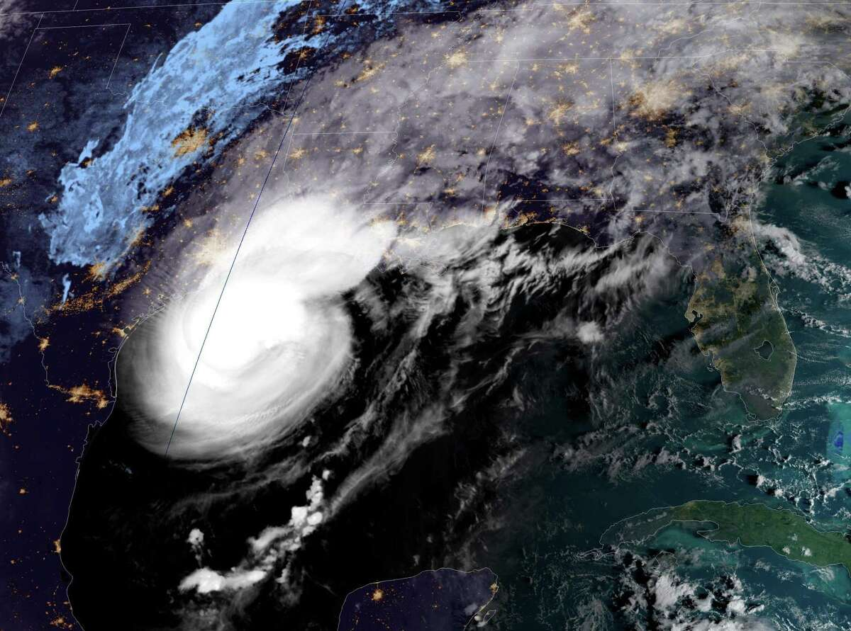 This National Oceanic and Atmospheric Administration satellite image shows Hurricane Delta moving towards the US on October 9, 2020, at 12:21UTC. - Delta was packing sustained winds of 120 miles per hour (195 kph), the US National Hurricane Center (NHC) said, with landfall expected October 9 in the evening. It is now a Category 3 storm, which means