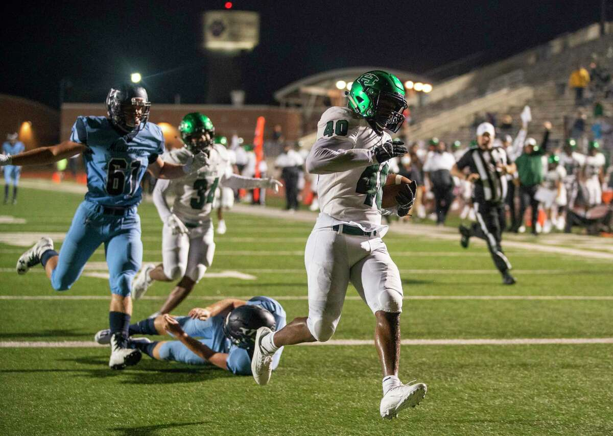 Huntsville's Quaterian Riles runs back a fumble for a touchdown to give the Hornets a 21-0 lead during the second half of a game between the Huntsville Hornets and the Kingwood Mustangs on Thursday, Oct. 8, 2020, at George Turner Stadium in Humble.