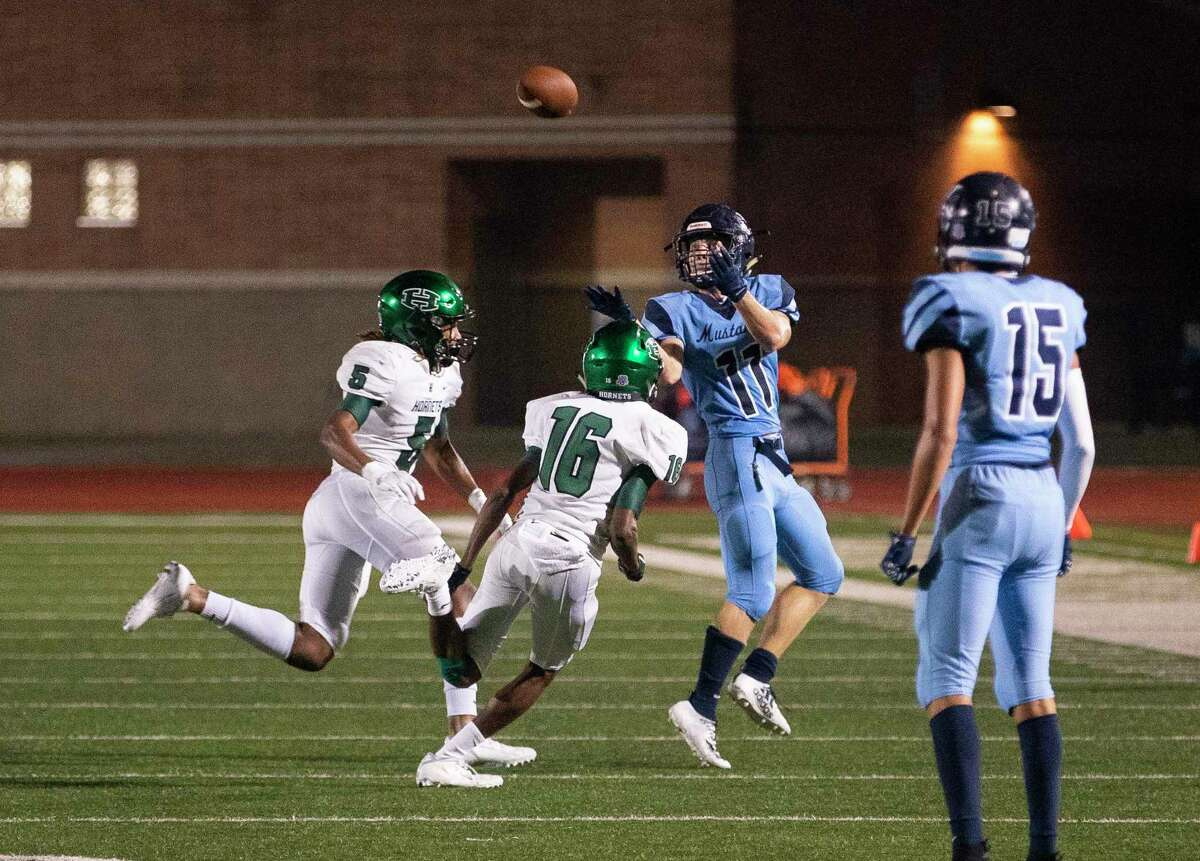 Kingwood's Jack Dugas hauls in a reception during the second half of a game between the Huntsville Hornets and the Kingwood Mustangs on Thursday, Oct. 8, 2020, at George Turner Stadium in Humble.