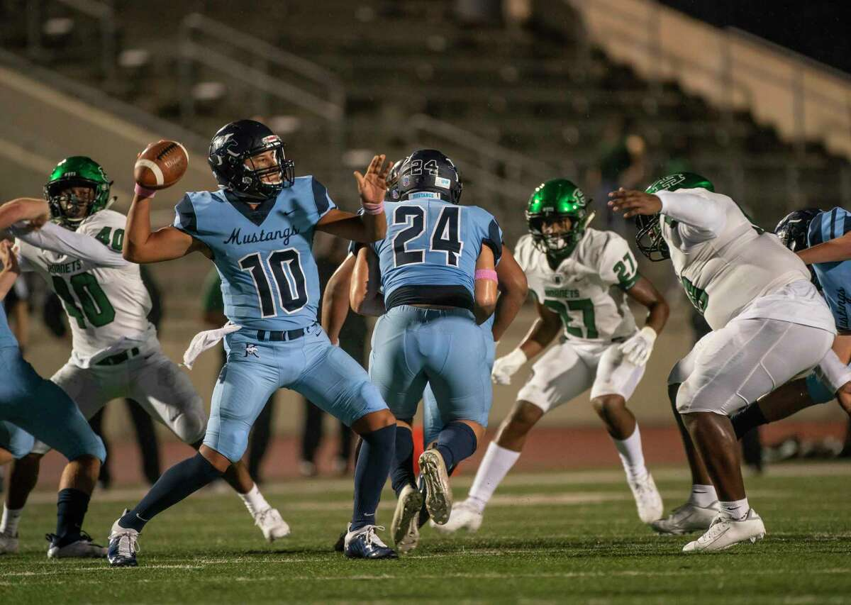 Kingwood quarterback Jonathan Mendoza looks to pass during a game between the Huntsville Hornets and the Kingwood Mustangs on Thursday, Oct. 8, 2020, at George Turner Stadium in Humble.