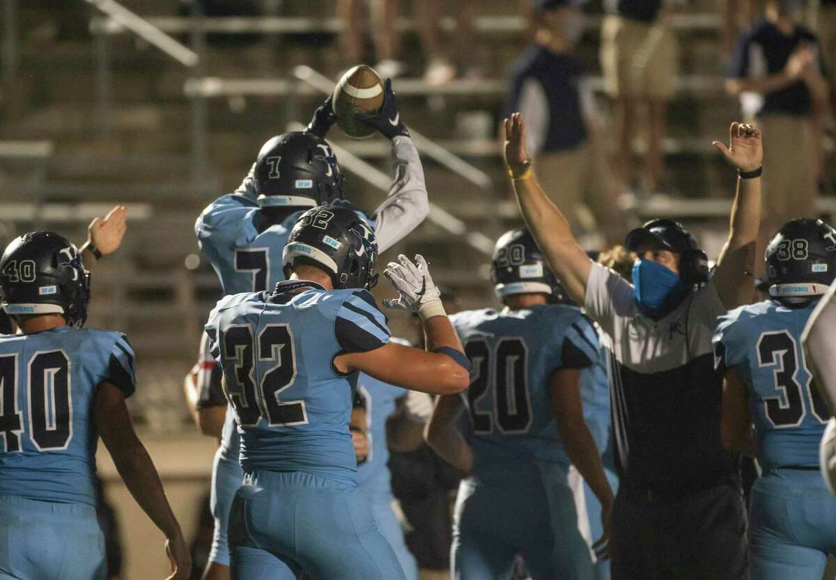 Kingwood's Michael Williams (7) celebrates a fumble recovery during a game between the Huntsville Hornets and the Kingwood Mustangs on Thursday, Oct. 8, 2020, at George Turner Stadium in Humble.