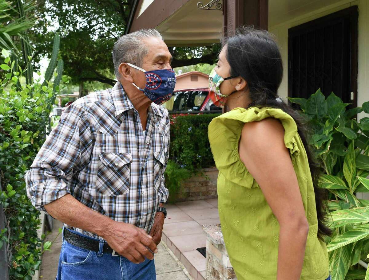 Rocha Garcia gives her father, Valeriano Rocha, a masked air kiss. An only child, the councilwoman takes care of her elderly parents.