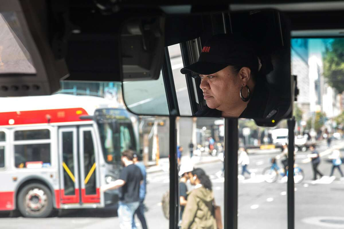 Diane Ulu drives the 14 Mission bus line along Mission Street.