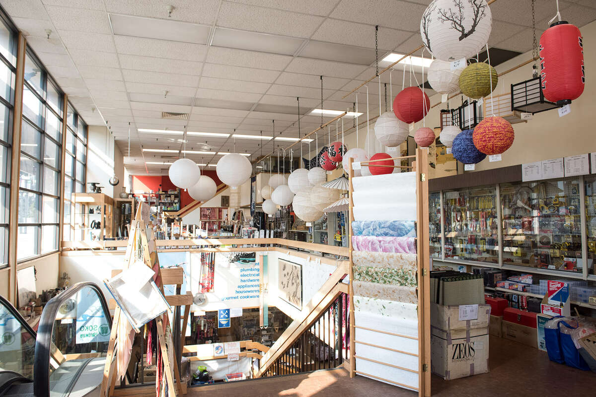 The street level of Soko Hardware is filled with sunlight and paper lanterns.