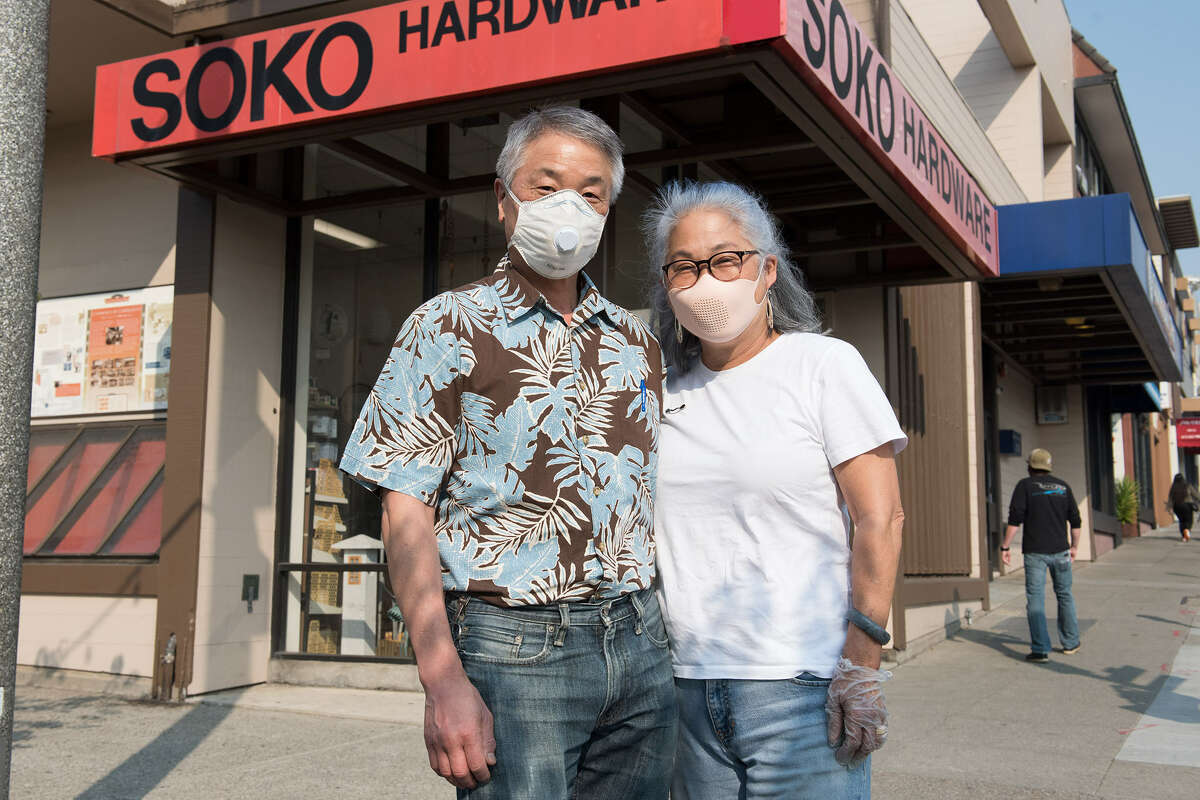 Phillip, left, and Eunice Ashizawa pictured in front of their hardware store, Soko Hardware.