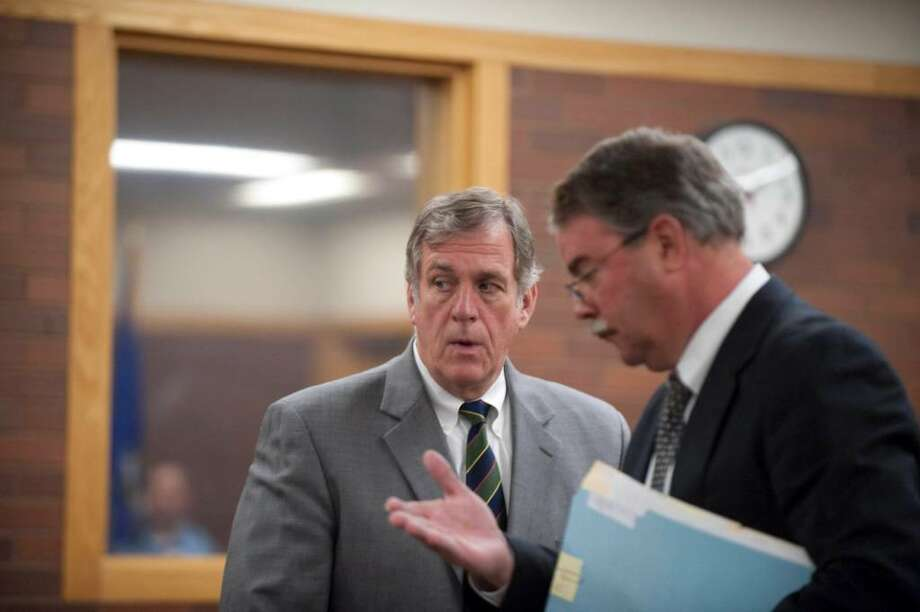 Bethel Conn. First Selectman Robert Burke left,  leaves the courtroom  with his attorney Thomas Beecher,  from  his arraignment in Danbury Conn. Superior Court on allegations of harassment charges in connection with repeated phone calls to a woman. (AP Photo/Douglas Healey). Photo: Douglas Healey, AP / FR12849AP