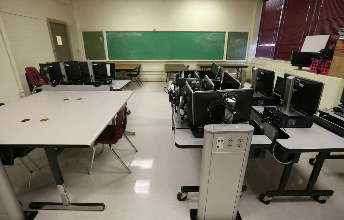 An outdated classroom is seen in SAISD's Rhodes Middle School. If voters approve the largest municipal or school bond issue in San Antonio history on Nov. 3 - two propositions totaling $1.3 billion - the district will completely overhaul Rhodes, to the tune of $47.4 million.