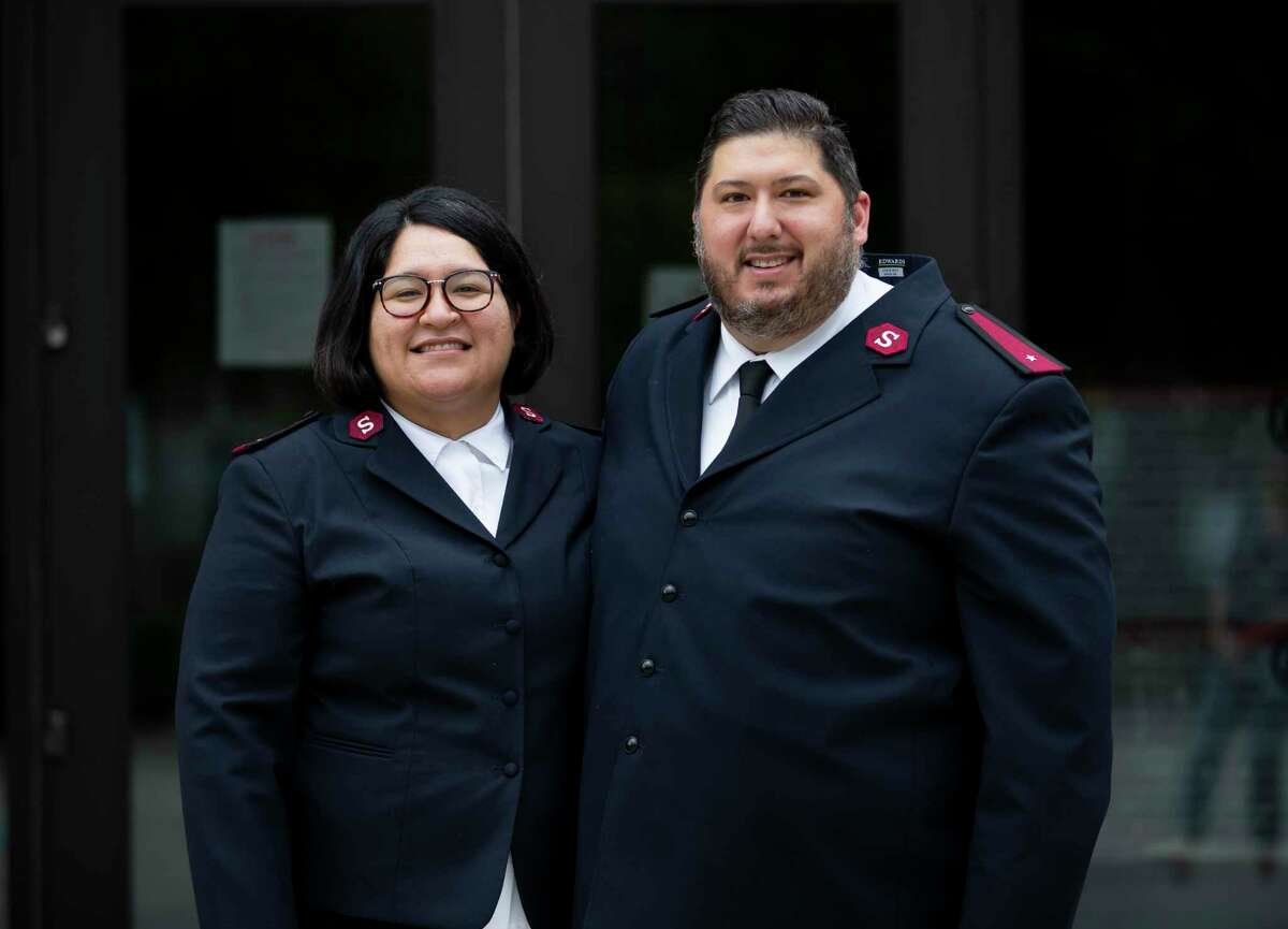 Claudia and James Guzman pose for a portrait in front of the Salvation Army emergency shelter in Conroe, Tuesday, Sept. 8, 2020. Lt. James Guzman recently spoke to the Conroe Noon Kiwanis Club.