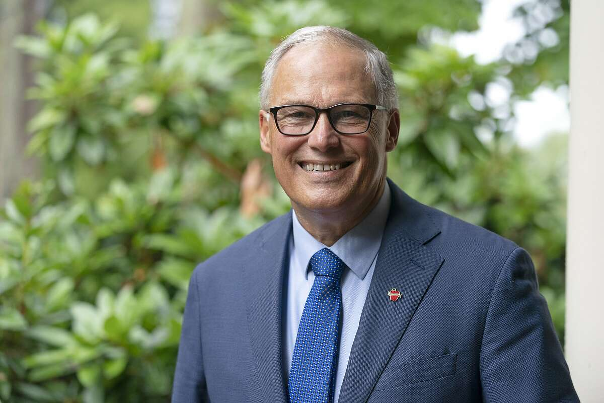 Washington Gov. Jay Inslee poses for a photo, Friday, Sept. 25, 2020, in Olympia, Wash. Inslee, a Democrat, is being challenged by Republican Loren Culp, police chief of the small town of Republic, Wash., in the Nov. 3 election. (AP Photo/Ted S. Warren)