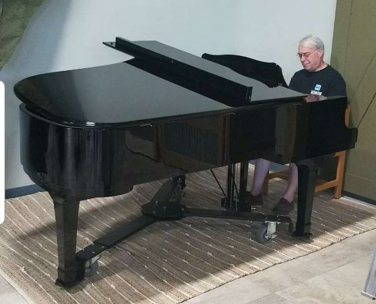 """Dr Dan Karp plays the Piano at Honor Cafe each Sunday for Brunch. On Thursday, Oct.22, he will be joined by 30-plus other musicians for The Rotary Club of Conroe's new """"In Spirit of Spirits of Texas"""" FUNraiser at the cafe. This will be a Big Band/WWII Era themed event to support the great charitable work of RCC."""