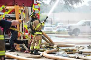 Firefighters from Spring, Ponderosa, Little York, Klein, and The Woodlands Fire Departments battle a multi-alarm fire at the Motel 6 on Cypresswood CT in North Harris County Oct. 9, 2019.
