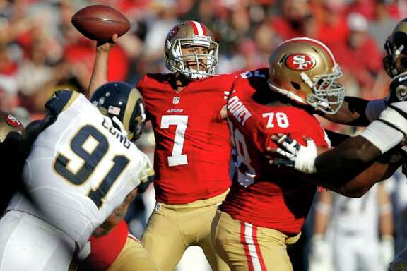 Above, 49ers' quarterback Colin Kaepernick led a 23-13 win over the St. Louis Rams on Dec. 1, 2013, at Candlestick Park.