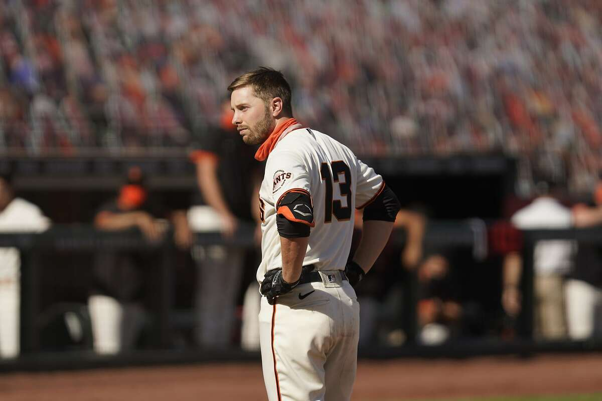 Left, Houston's Ryan Pressly celebrates after a bad call for strike 3 ended the A's season. Right, Austin Slater digests a similar call that ended the Giants' year.
