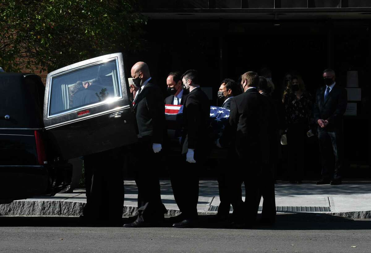 Former Senate Majority Leader Joseph L. Bruno is carried from St. Pius X Church following funeral services on Friday, Oct. 9, 2020, in Colonie, N.Y. Sen. Bruno passed away on Tuesday at age 91. (Will Waldron/Times Union)