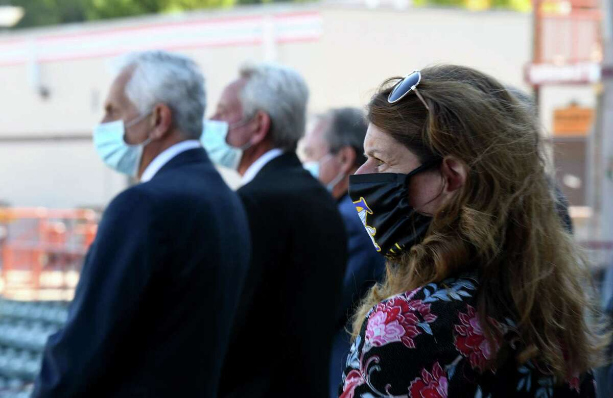 Troy City Council President Carmella Mantello, right, joins fellow Rensselaer County dignitaries as they pay their respects to former Senate Majority Leader Joseph L. Bruno during a funeral procession around the bases at Joseph L. Bruno Stadium on Friday, Oct. 9, 2020, in Troy, N.Y. Sen. Bruno passed away on Tuesday at age 91. (Will Waldron/Times Union)