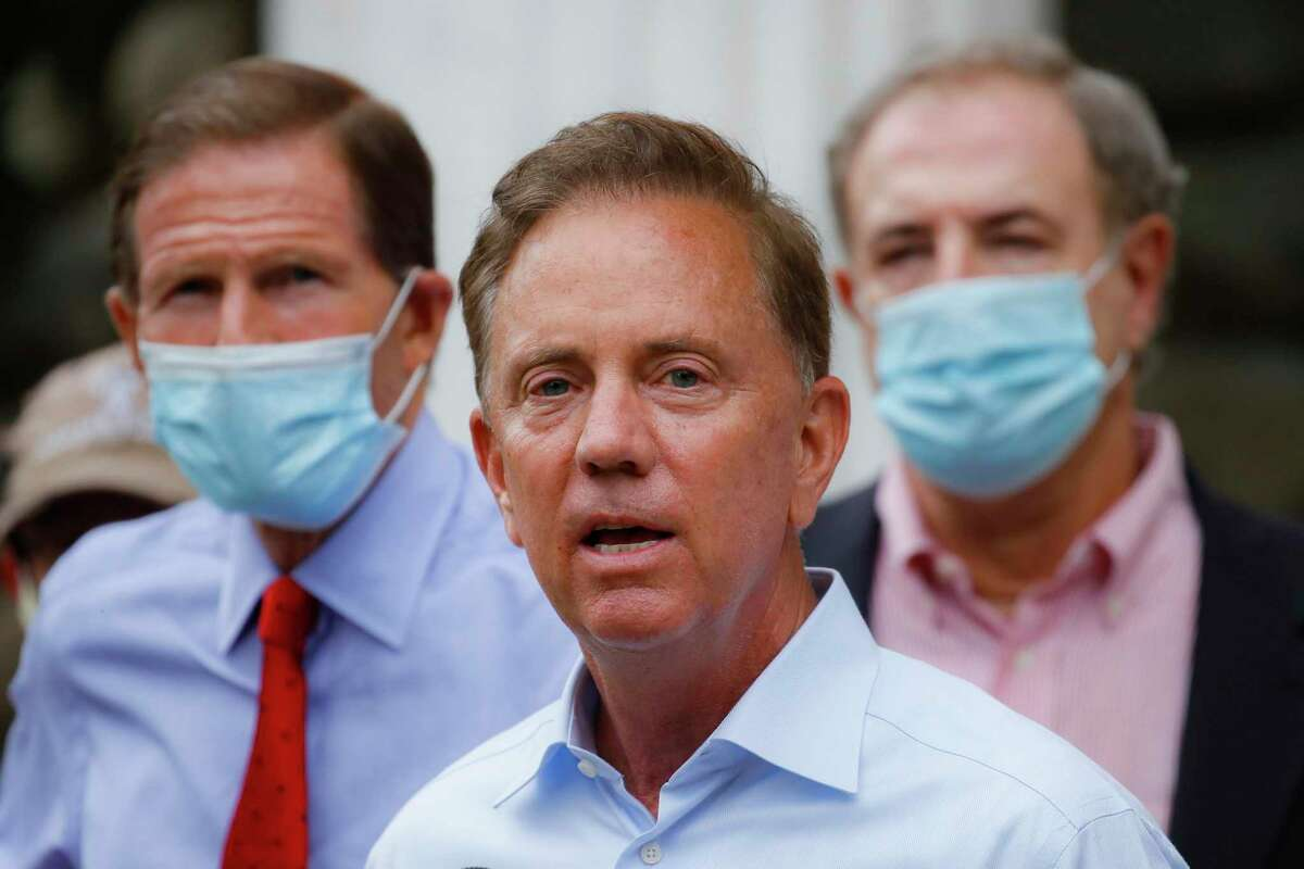 FILE- In this Aug. 7, 2020, file photo, Connecticut Gov. Ned Lamont addresses the media in Westport, Conn. Lamont said on Tuesday, Sept. 29, 2020, that Connecticut expects to receive about 1 million new rapid tests for the new coronavirus from the federal government and will use them to help make sure schools stay open. (AP Photo/John Minchillo, File)
