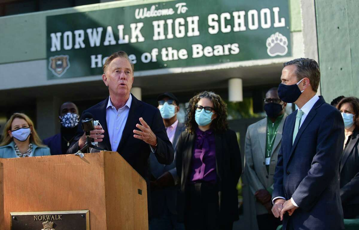 Governor Ned Lamont holds a bill signing ceremony for House Bill 7010, An Act Concerning the Authorization of State Grant Commitments for School Building Projects, Friday, October 9, 2020, at Norwalk High School in Norwalk, Conn. A new Norwalk High is included in this construction bill.