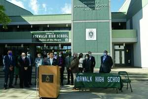 Dignitaries and local officials including State Senate Majority Leader Bob Duff join Governor Ned Lamont as he holds a bill signing ceremony for House Bill 7010, An Act Concerning the Authorization of State Grant Commitments for School Building Projects, Friday, October 9, 2020, at Norwalk High School in Norwalk, Conn. A new Norwalk High is included in this construction bill.