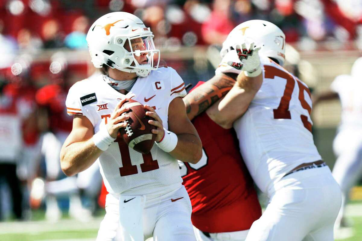 FILE - In this Saturday Sept. 26, 2020, file photo, Texas quarterback Sam Ehlinger looks for an open receiver during the first half of an NCAA college football game against Texas Tech in Lubbock, Texas. No. 22 Texas vs. Oklahoma, at Cotton Bowl Stadium, Dallas. There is no State Fair of Texas this year because of the pandemic and both teams are coming off a loss, but this is still the Red River rivalry. (AP Photo/Mark Rogers, File)