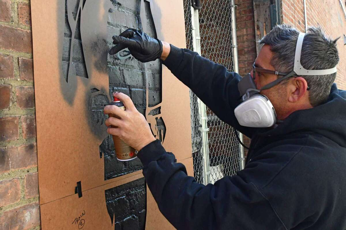 Artist Joe Iurato paints a mural in Franklin Alley on Friday, Oct. 9, 2020 in Troy, N.Y. The city's Franklin Alley project is getting closer to a finish. (Lori Van Buren/Times Union)