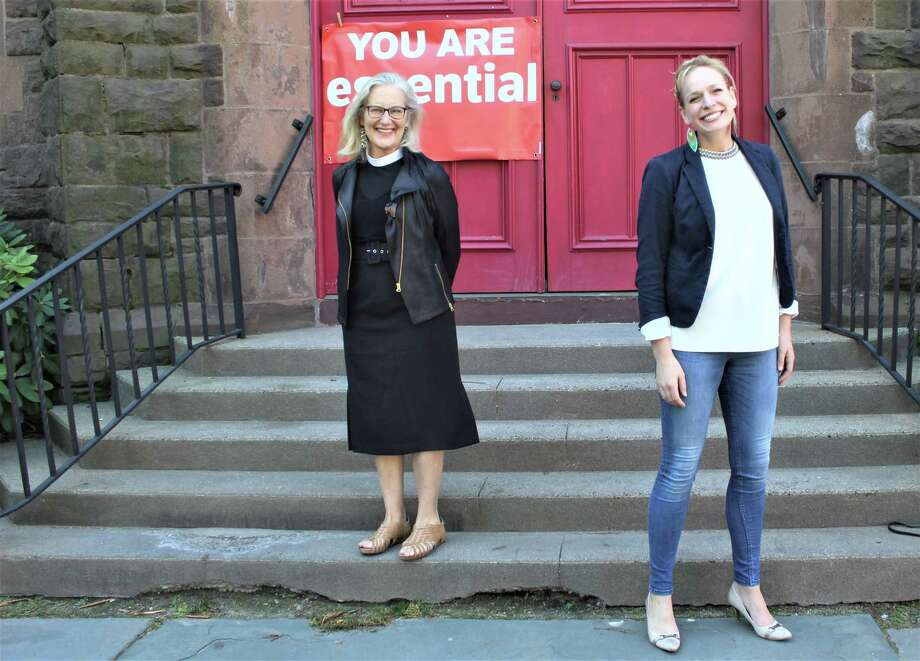 From left, Church of The Holy Trinity Rev. Mary Barnett and Ekklesia Contemporary Ballet founder and artistic director Elisa Schroth stand in front of the 381 Main St. building Friday afternoon. Photo: Cassandra Day / Hearst Connecticut Media