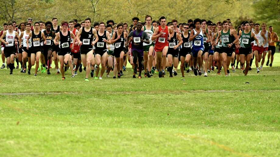 The start of the SCC boys cross country championship at East Shore Park in New Haven in 2019. Things will look differently this season with staggered start times, both boys and girls, throughout the championship meet because only 50 runners are allowed per race due to COVID-19. Photo: Peter Hvizdak / Hearst Connecticut Media / New Haven Register