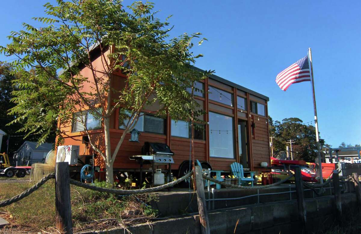 An exterior view of the tiny home of John McCarthy and his wife, Amy Garner, along the waterfront in New Haven, Conn., on Thursday Oct. 8, 2020.