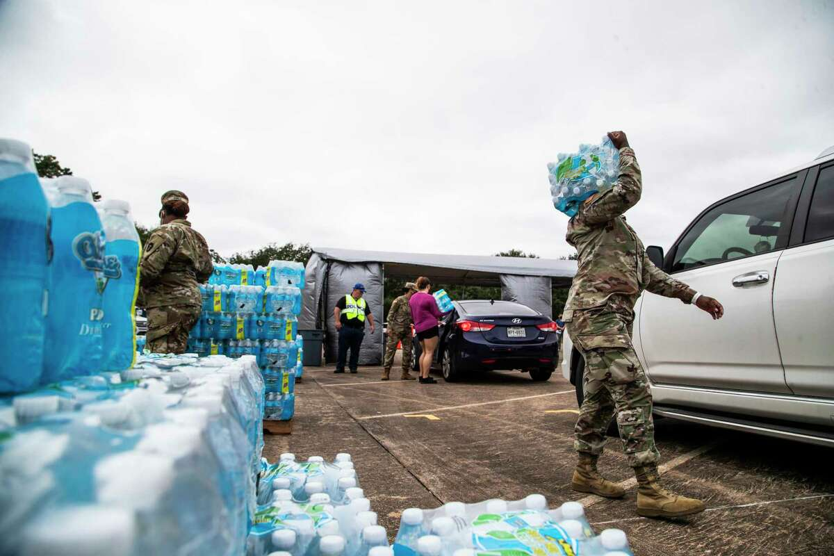 National Guard soldiers and City of Lake Jackson employees distribute bottled water to residents Monday, Sept. 28, 2020, in Lake Jackson, Texas. Texas Governor Greg Abbott issued a disaster declaration on Sunday after a brain-eating amoeba was discovered in the water supply for Lake Jackson, Texas. The disaster declaration extends across Brazoria County, where Lake Jackson is located.T he disaster declaration followed the death of a 6-year-old boy who was infected by a brain-eating amoeba.
