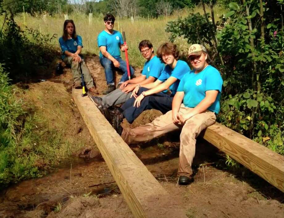 EcoCorps crew members take a break during construction of a new puncheon boardwalk at Sawdust Hole. This piece of the project took place during the 2019 season. Pictured (from left) areIsaac Lemmen, Alex Myers, Nick Costales, Drew Gang and Caden Teichman.(Courtesy Photo/Elizabeth Dunham)