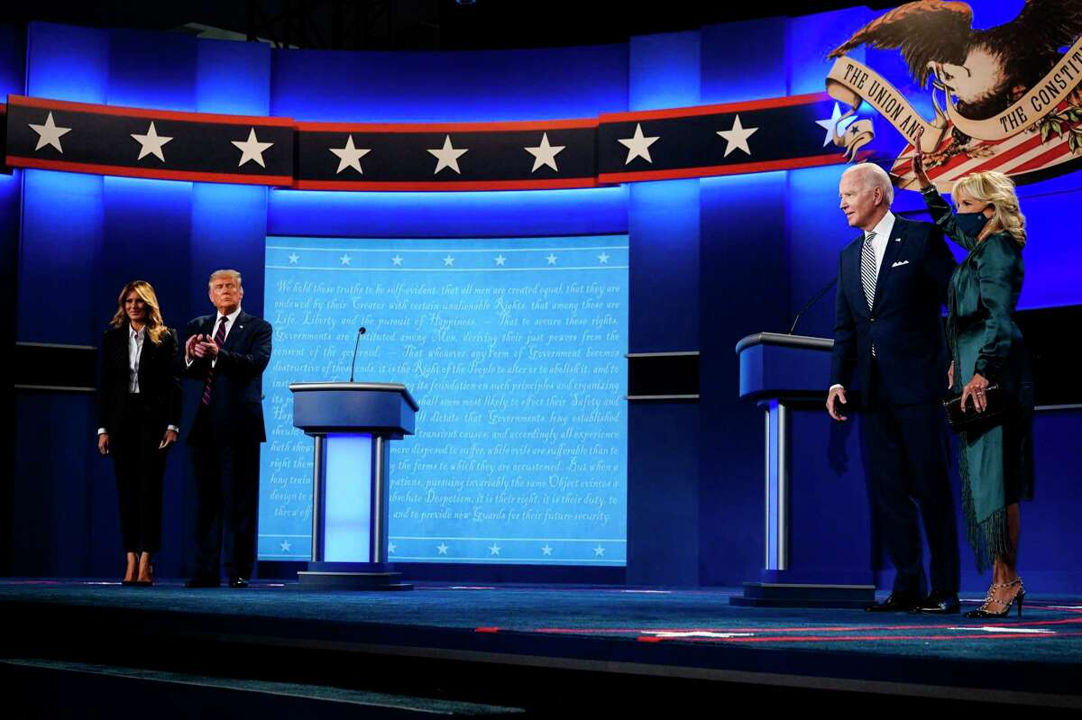 President Donald Trump with first lady Melania Trump and former Vice President Joe Biden with Jill Biden stand on the stage at the conclusion of the first presidential debate at Case Western Reserve University in Cleveland on Sept. 29, 2020. MUST CREDIT: Washington Post photo by Melina Mara