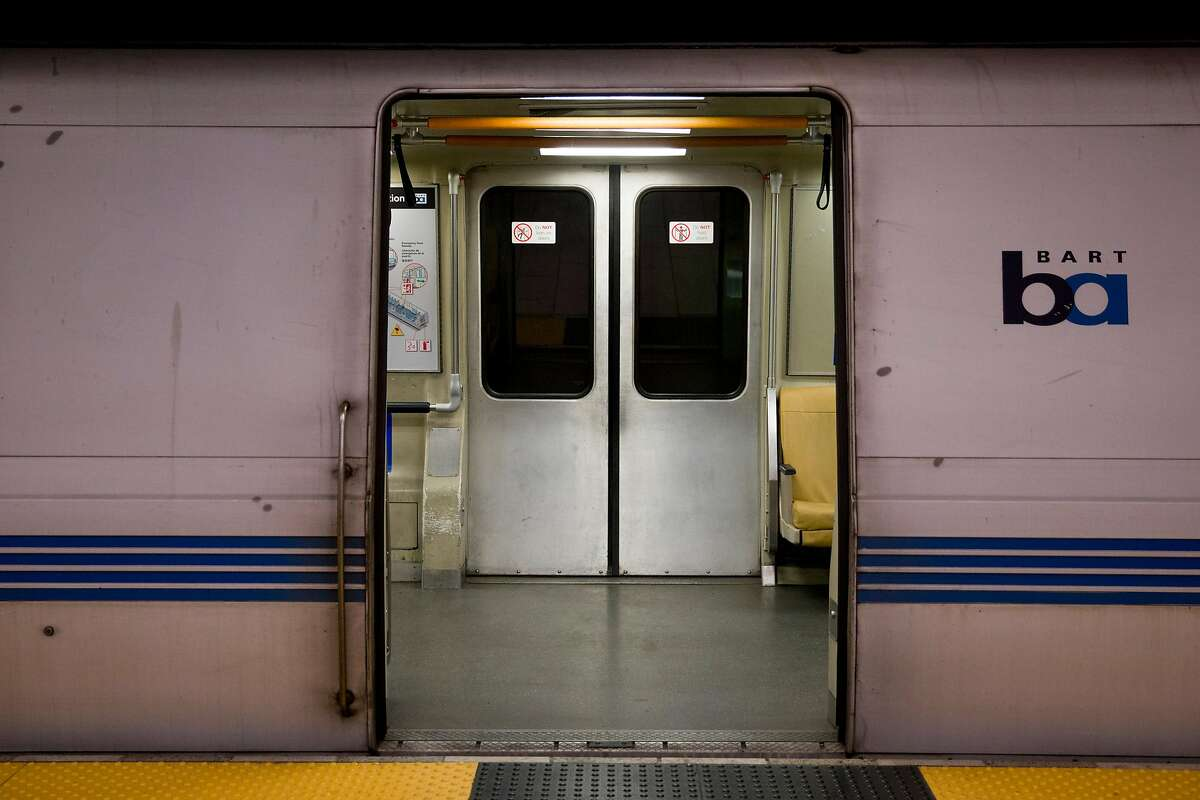 Doors open to an empty train during the morning commute at the 19th Street BART Station in Oakland in April. Ridership on public transit has plummeted during shelter-in-place. A huge drop in sales and rents indicate people are leaving San Francisco.