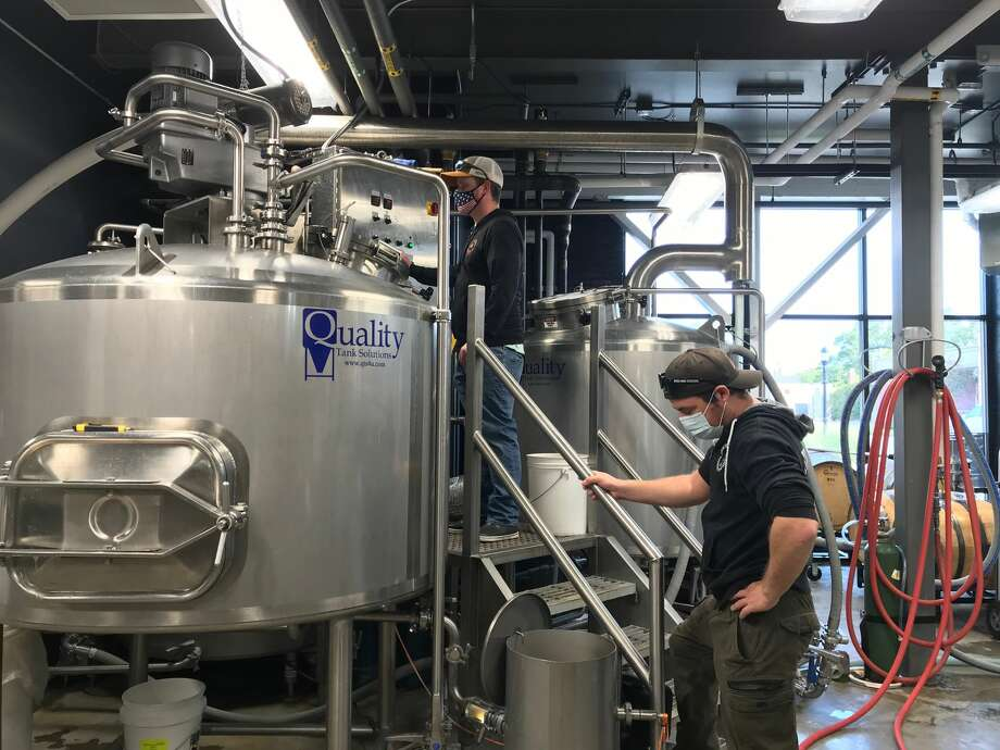 Jamieson Hanna, North Channel Brewing Company head brewer, and Sam Sacksteder, assistant brewer, prepare to move wort into the boil kettle. Photo: Erin Glynn/Manistee News Advocate