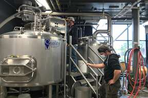 Jamieson Hanna, North Channel Brewing Company head brewer, and Sam Sacksteder, assistant brewer, prepare to move wort into the boil kettle.