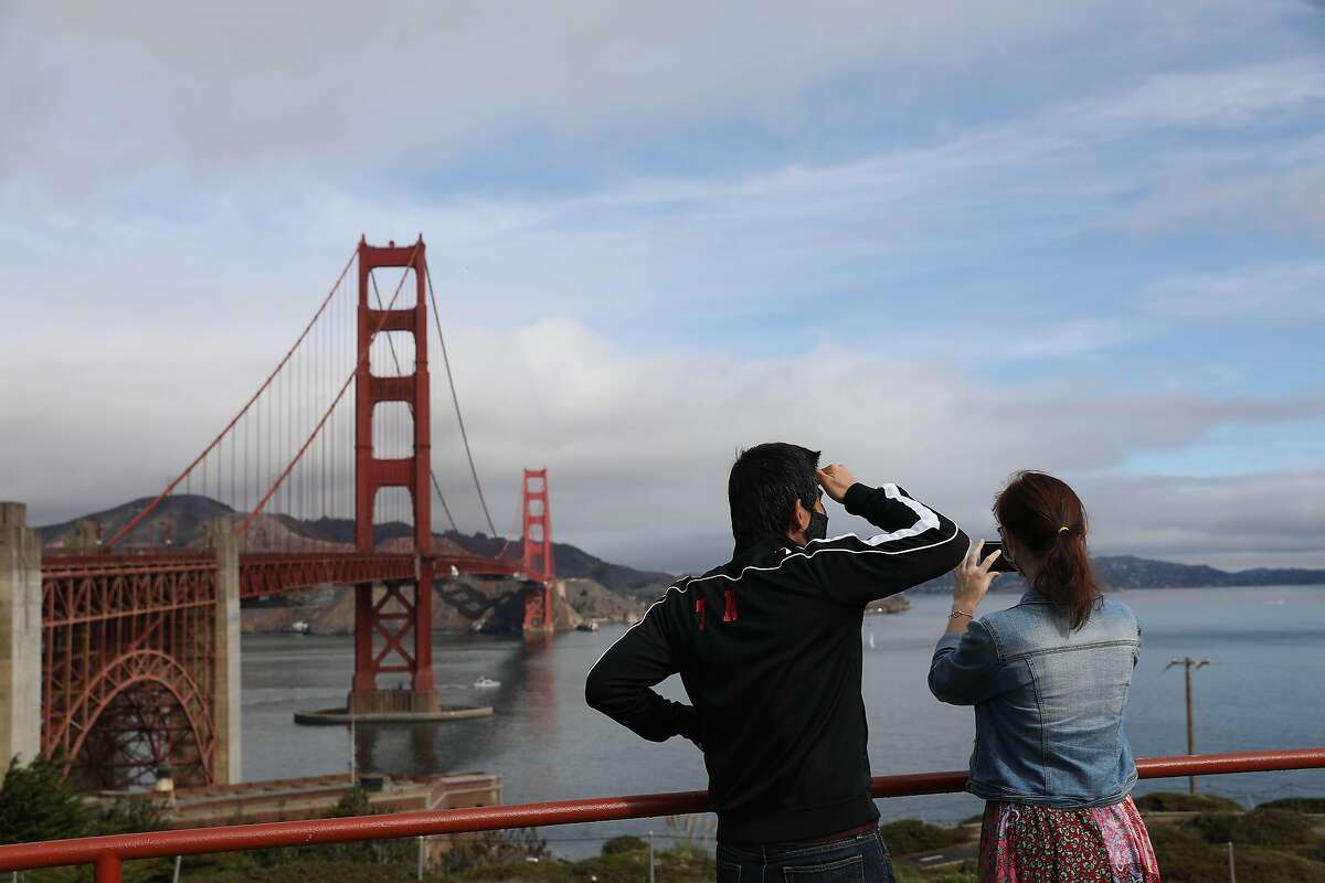 Tran Nguyen of San Francisco and Meriam Rumai of Oklahoma take in the view of the Golden Gate Bridge and San Francisco Bay as Nguyen takes Rumai on a tour of San Francisco late last year.