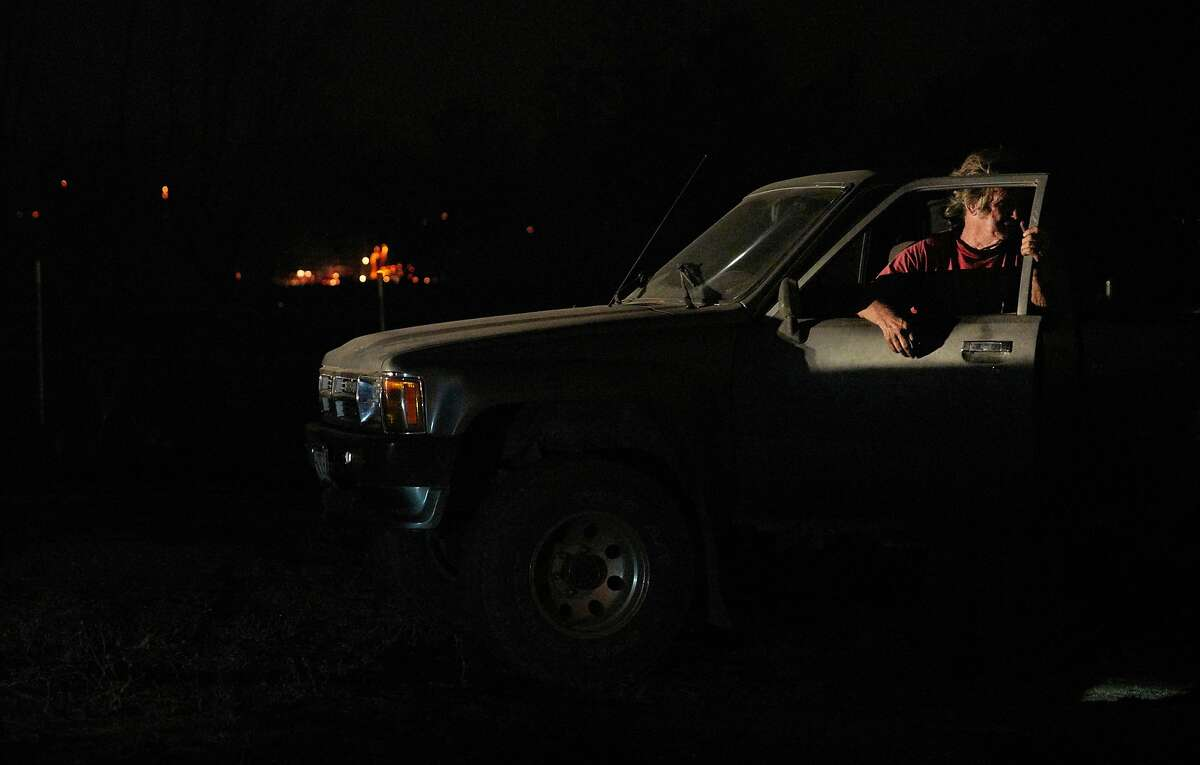 Homeowner Tom Smith watches the Zogg Fire near his home on Platina Road in Igo on Sept. 27.