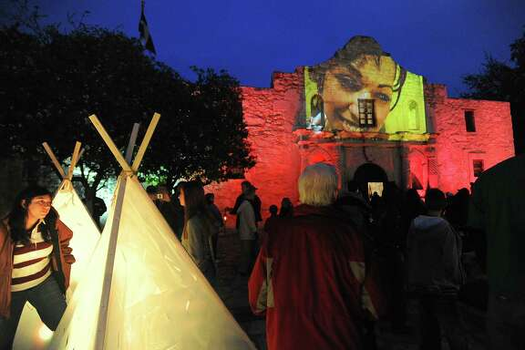 A video showing indigenous and mestizo people of Texas is projected onto the Alamo's shrine during an art presentation in 2009.