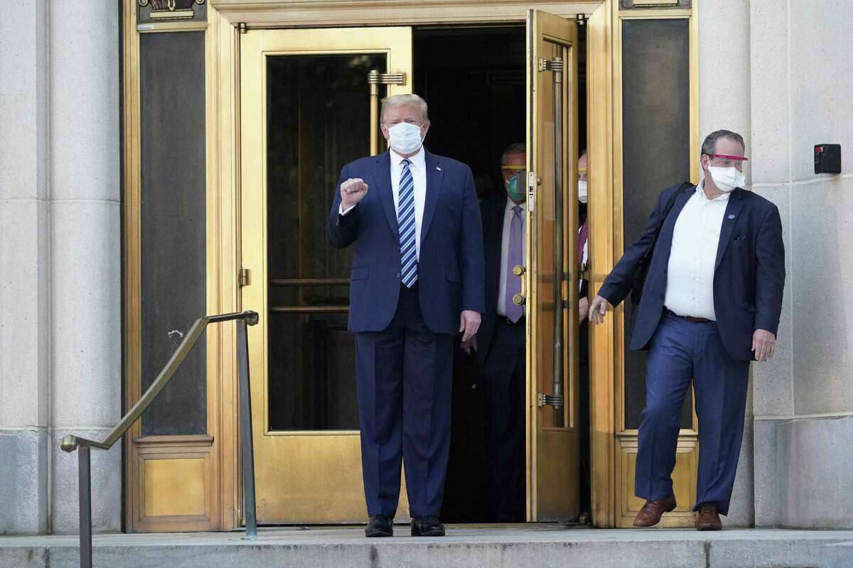 President Donald Trump emerges from the front door of Walter Reed National Military Medical Center to board Marine One for a return trip to the White House on Oct. 5. A reader saw political theatrics.