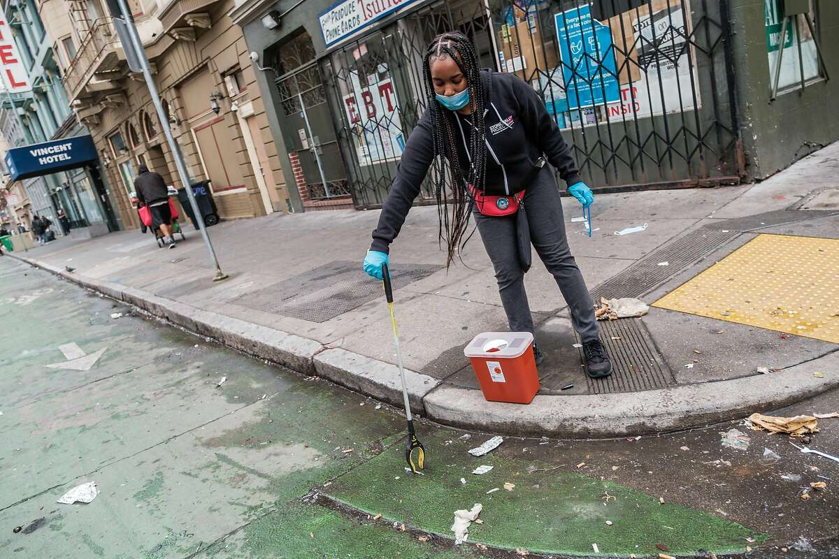 Brittaney Falley, a syringe disposal associate with the San Francisco AIDS Foundation, picks up discarded needles, pipes and other drug paraphernalia in San Francisco's Tenderloin last year. Mayor London Breed demanded clarity from the Biden administration Wednesday over whether opening a safe injection site would violate federal law.