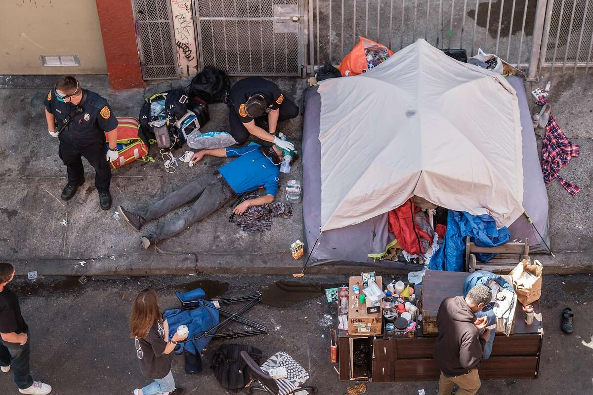 Paramedics work to revive an overdose victim in S.F.'s Tenderloin last year. London Breed joined several other mayors seeking clarity from the Biden administration Wednesday on whether opening a safe injection site would violate federal law.