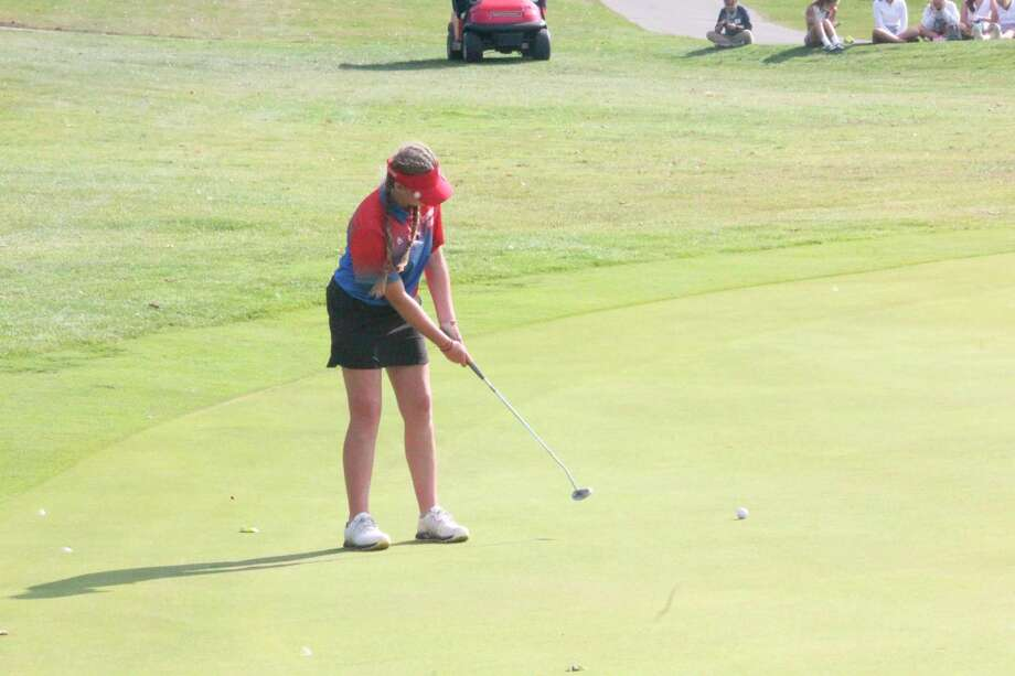 Ryleigh Allen watches her putt for Chippewa Hills during Friday's Cardinal Invitational at Katke Golf Course. (Pioneer photo/John Raffel)